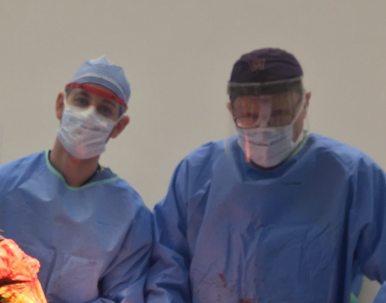 Orthopedic surgery resident Dan Tobert and Dr. Thornhill performing a total knee replacement.