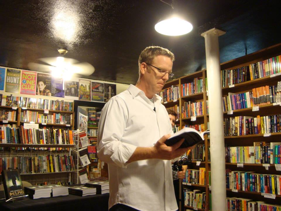 "A dramatic reading from ""The League of Delphi: Book I of The Delphi Trilogy"" at Once Upon a Crime Books."