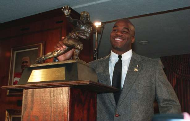 Rashaan Salaam  accepting the Heisman Trophy in 1994. Rashaan was a 1st Round Pick for the Chicago Bears in the 1995 NFL draft.