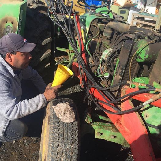 The amazing Javier, fixing an older John Deere tractor. 20 years working here on our farm!