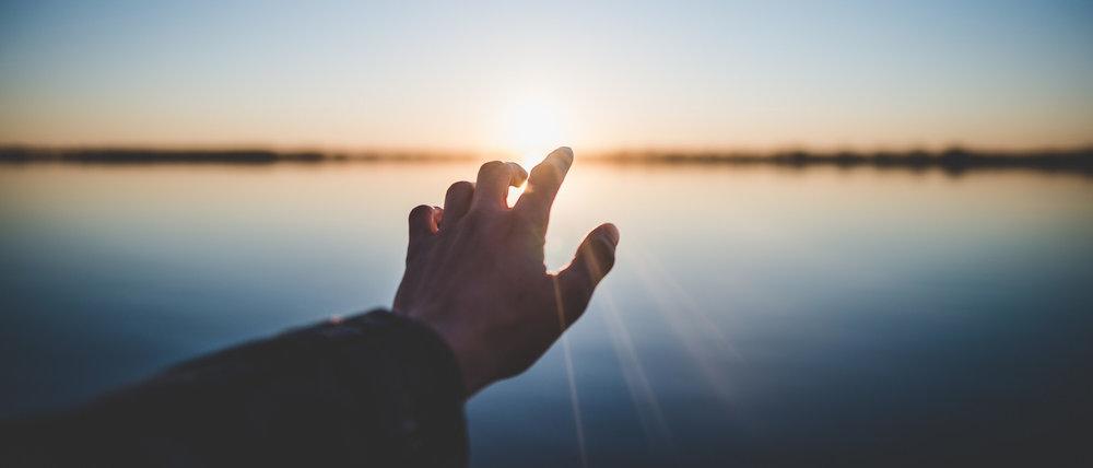 Hand+Reaching+to+the+Rising+Sun.jpg