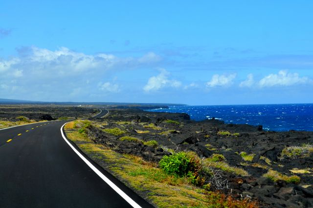 We drive to the coast to get close to the current active lava flow, which is flowing into the ocean and making new land