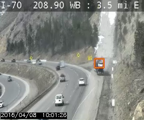 A stopped vehicle is detected at the base of a runaway truck ramp.