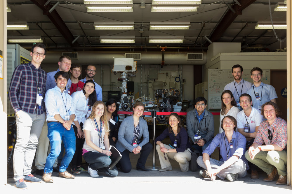 Team Explorer in front of the Curiosity Rover