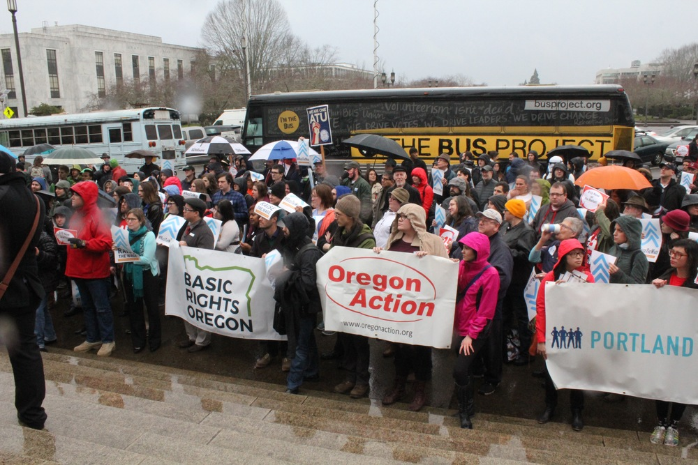 Oregonians rally to raise the wage in front of The Bus!