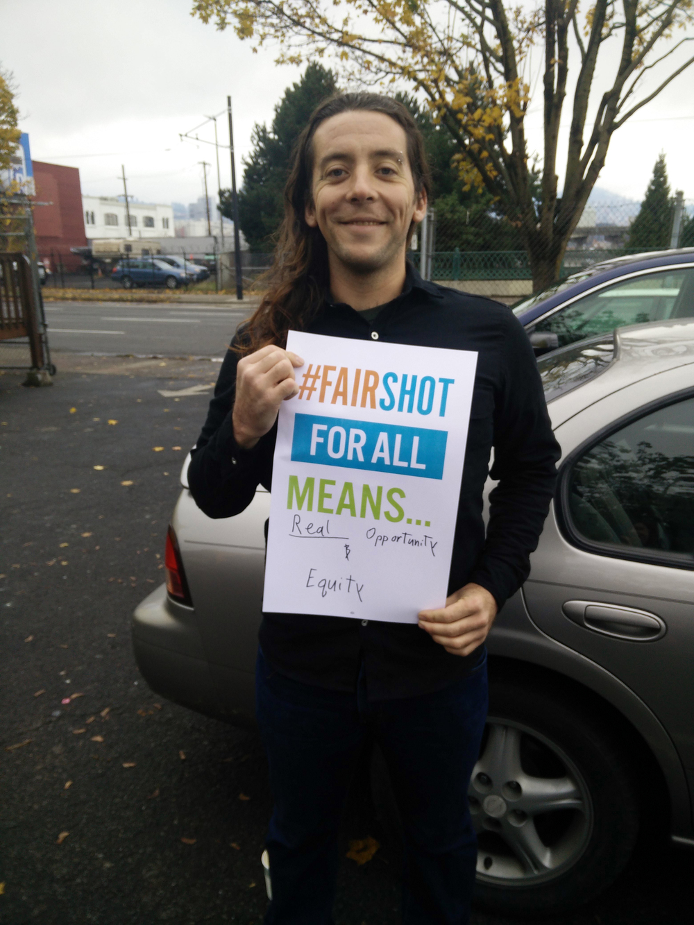 Impact NW and YWCA intern Alex at the Fair Shot for All 2016 Agenda Launch.