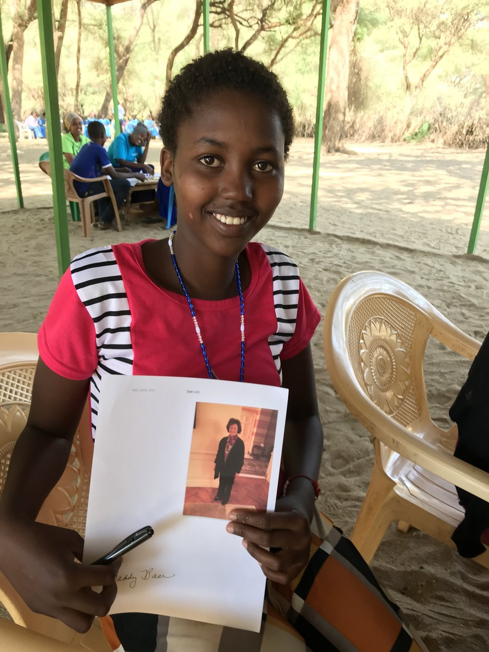 Monica - Monica is from South-Horr, Kenya. She lives with her mother and five brothers. Monica attends the Irene School in Samburu County. She is very focused on her studies, doing her best in secondary school.