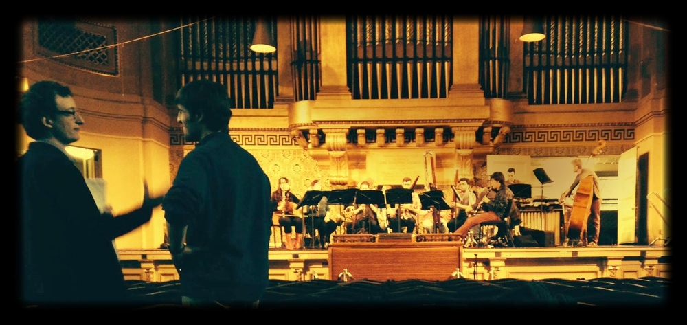 Rehearsal in Woolsey Hall with conductor Jonathan Brandani