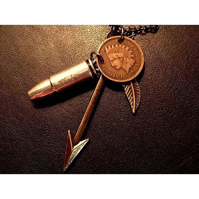 "So, @1888Design made this amazing custom piece for me, and is featuring it on their site! - The downward pointing arrow is a Native American symbol of peace, the feather is for following your dreams and for luck, the Indian head penny is for life and/or things not always being what they seem, and the bullet is worn to represent a ""bullet meant for you,"" so if you are wearing it, it can't be used against you... I.E. Protection.  If y'all want this awesome necklace, just head to their website and snag them up before the limited run is gone! They also have other incredible pieces."