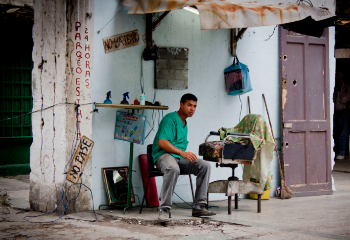 The barber chair comes in many different forms, including this open air edition in Cuba circa 2013.