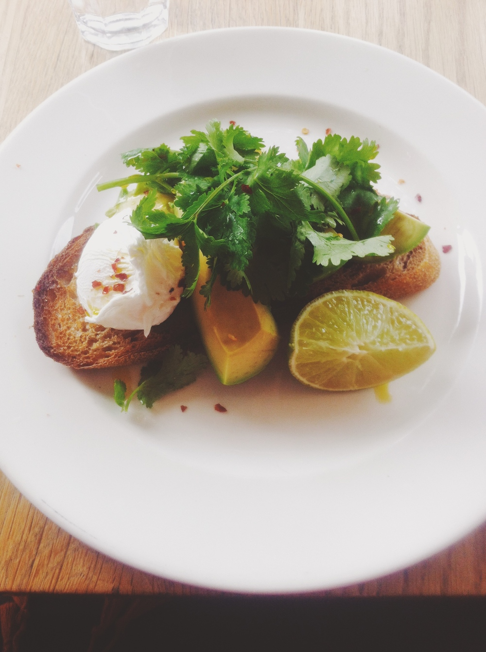 A fresh and light breakfast - poached egg with avacado and corriander