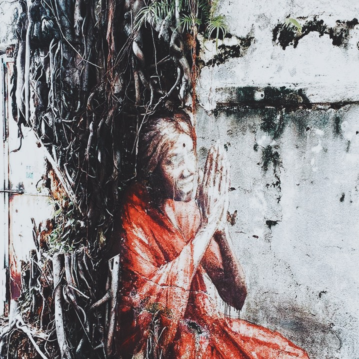 Wander: Street Art Penang Woman in tree.JPG