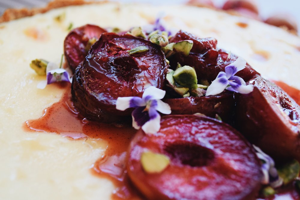 Roasted plums with pistachios & violets