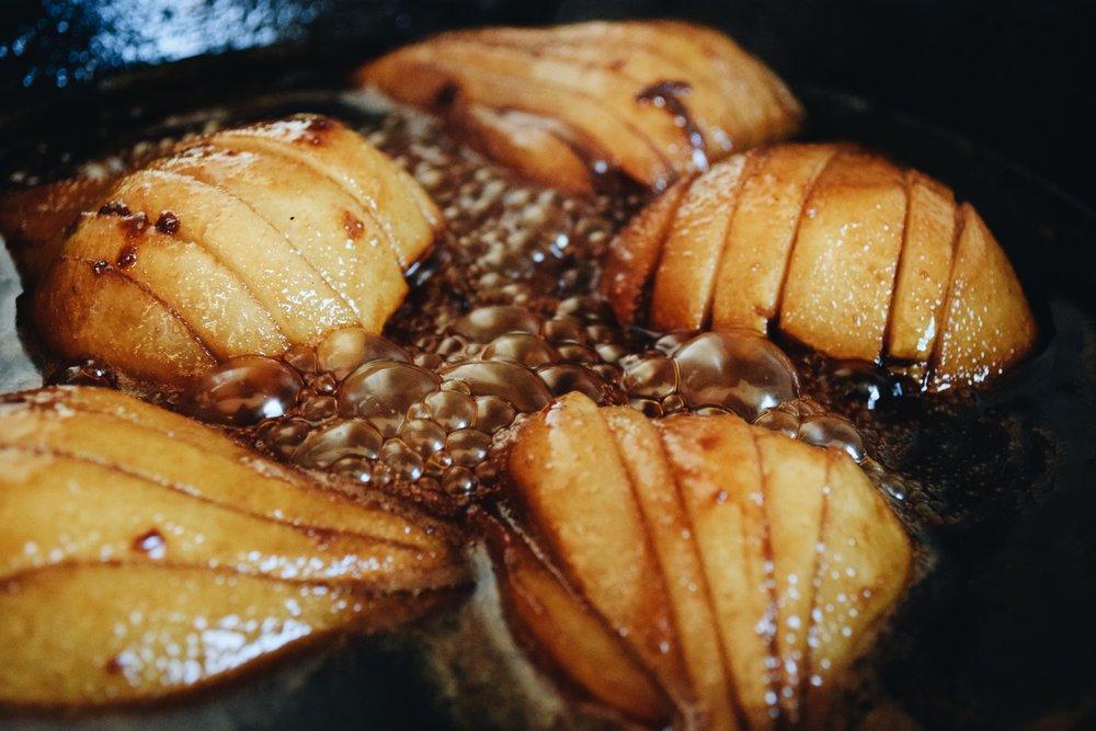 Pears bubbling in caramel
