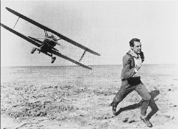Cary Grant is me. The plane is every deadline, ever. This photo will always be my favorite, and will always sum up my current situation.