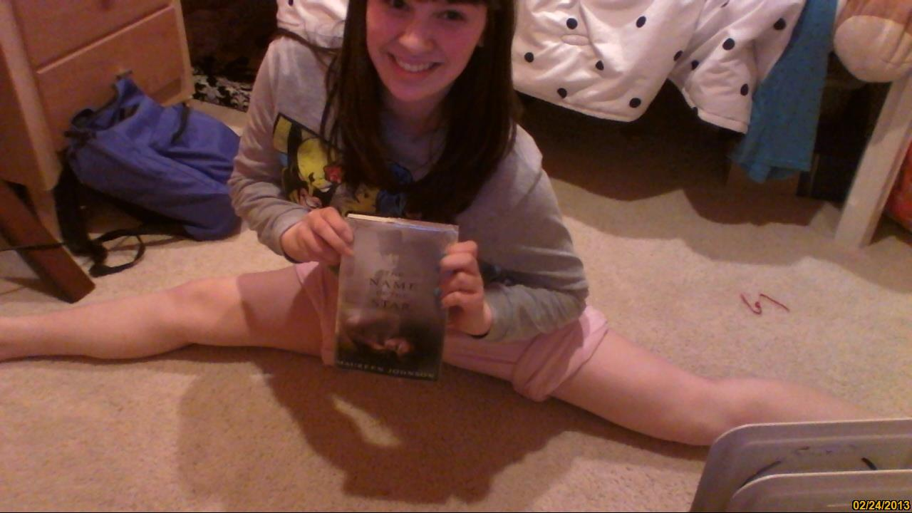 c-a-t-meow: Casually practicing my splits and reading NOS :) Physical fitness AND reading! This is the photo winner!
