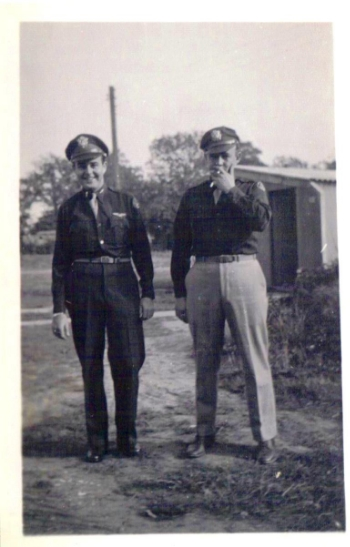 Left to right:  Carroll Snidow, Co-pilot; Maynard L. Jones, Navigator
