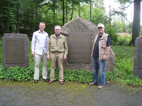 Tyler Barton, left, is hosted by German historian Walter Hassenpflug and translator Guenter Lemke at the German-American Airmen's Memorial to the Kassel Mission in July of 2012, not 2013.
