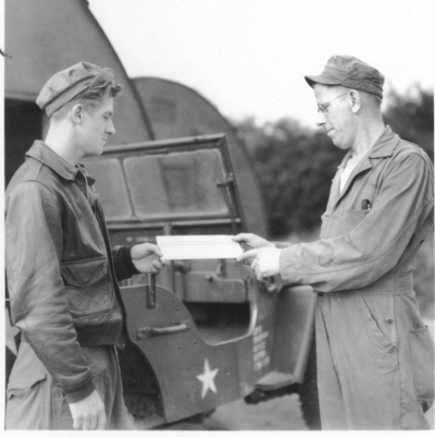 Hess, left, i his jacket, receives mail. Photo courtesy Tim Hess