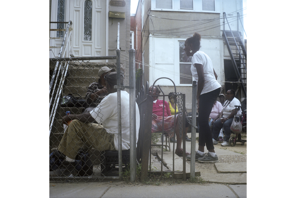 "Veronica (center, white shirt) raised six children in  the Northeast area of Washington D.C. ""I have an ""S"" on my chest,"" she says. But as developers move in, she isn't sure how long she will be able to afford to stay in this neighborhood where she has lived all her life. Washington D.C., August 2014."