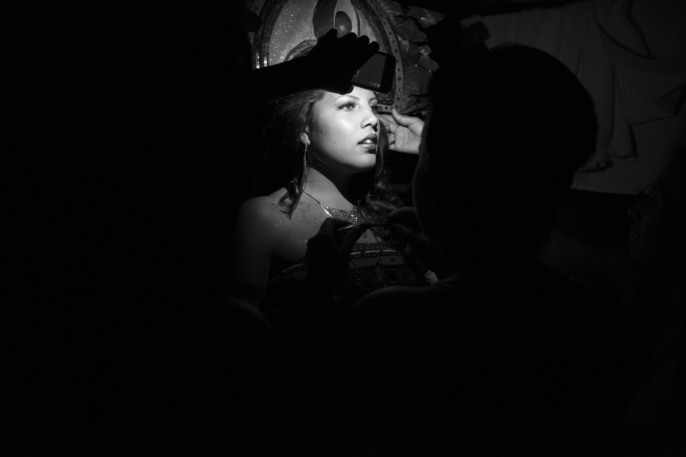 A cellphone is used for light during a brief power outage just before the start of the 2014 Miss Antigua beauty pageant. The winner will compete in the Miss Guatemala beauty pageant. Antigua, Guatemala. July 18, 2014.