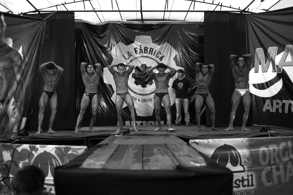 Competitors on stage at the the Gimnasio La Fábrica bodybuilding contest in Antigua, Guatemala on July 19, 2014.