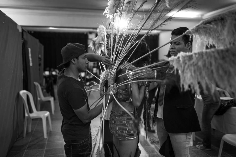 Rocio Barrios gets assistance from friends backstage at the 2014 Miss Antigua beauty pageant. The winner will compete in the Miss Guatemala beauty pageant. Antigua, Guatemala. July 18, 2014.