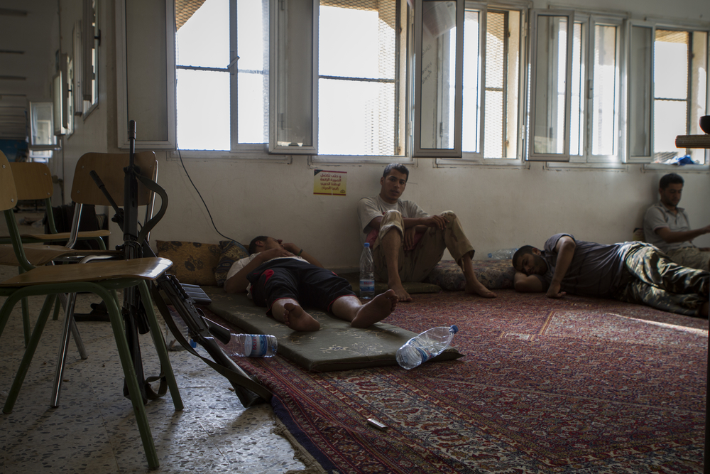 Members of a rebel battalion occupy a school to refit and prepare for their next operation. Zintan, Libya. July 20, 2011.