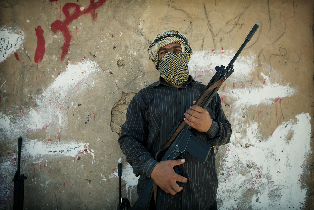 A rebel stands with his FN FAL STG 58, a 1950s era Austrian battle rifle, one month before the final assault on Tripoli. Kikla, Libya. July 16, 2011.