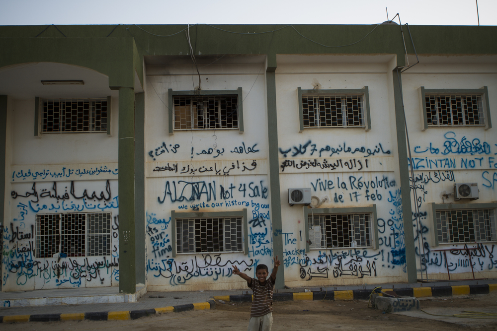 A government building in Zintan has slogans supporting the revolution, a free Libya, and a free Zintan. July 20, 2011