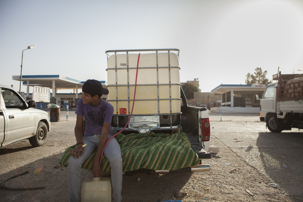 All the gas stations are closed in western Libya and all the fuel is being brought in from Tunisia. Gas is sold from tanks in the beds of pickup trucks. Jedu, Libya. July 16, 2011.