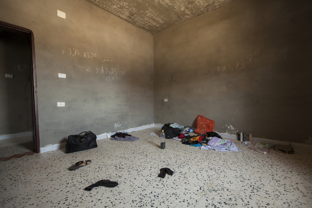 A family who fled Tripoli without telling anyone takes shelter in a bare house with no electricity in Zintan, Libya. July 19, 2011.