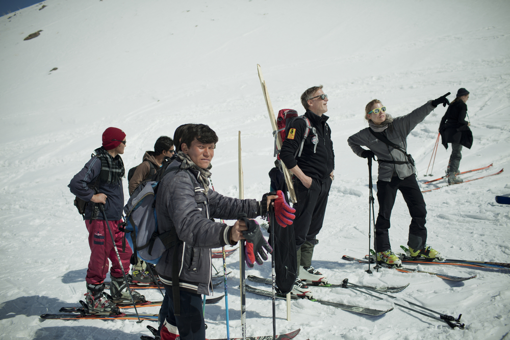 Christoph Zurcher, a Swiss skier and journalist, made his first visit to the Koh-e-Baba mountains around 2009. He decided a ski race would help motivate the locals to learn the sport, and he set about recruiting sponsors and participants. Here, Afghan skiers prepare for a training run before the competition. Koh-e-Baba Mountains, Afghanistan. March 1, 2012.