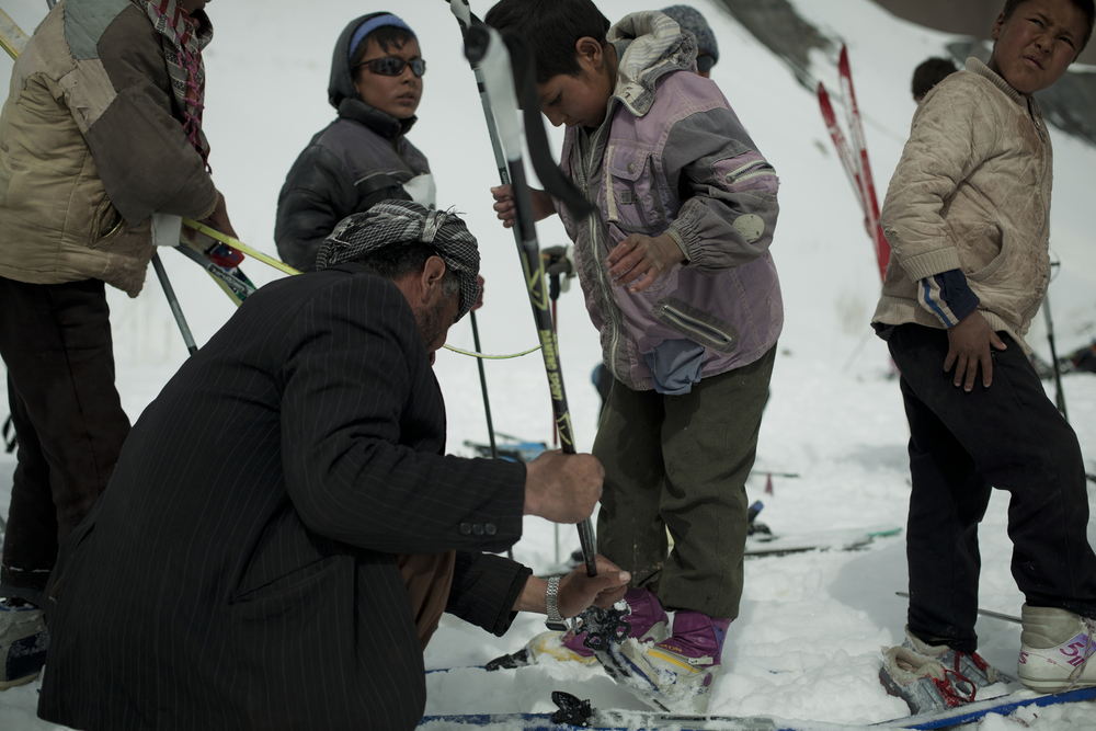 Though Afghanistan has plenty of snow-covered mountains, skiing is an extreme novelty in the country. Organizers of the ski challenge brought skis and boots so that spectators could try skiing as well. Bamiyan, Afghanistan. March 1, 2012.
