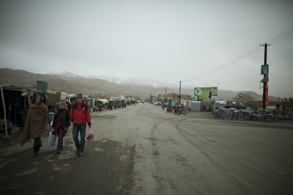 Western participants in the Ski Challenge walk through the main street of Bamiyan. Bamiyan, Afghanistan. March 2, 2012.