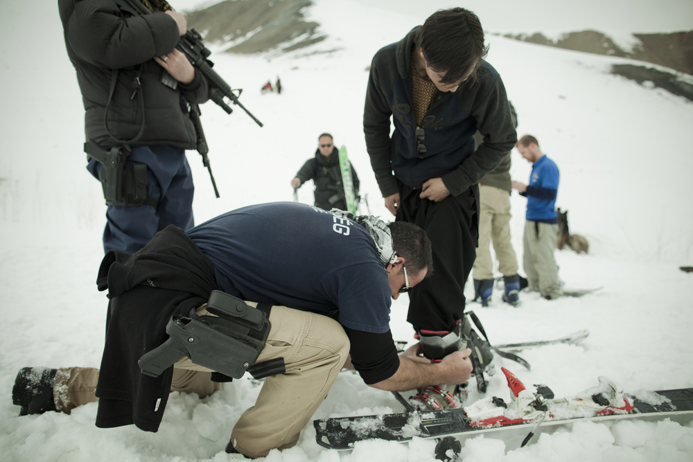 Members of the New Zealand military stationed in Bamiyan assist a local Afghan who is trying skiing for the first time. Koh-e-Baba Mountains, Afghanistan. March 2, 2012.