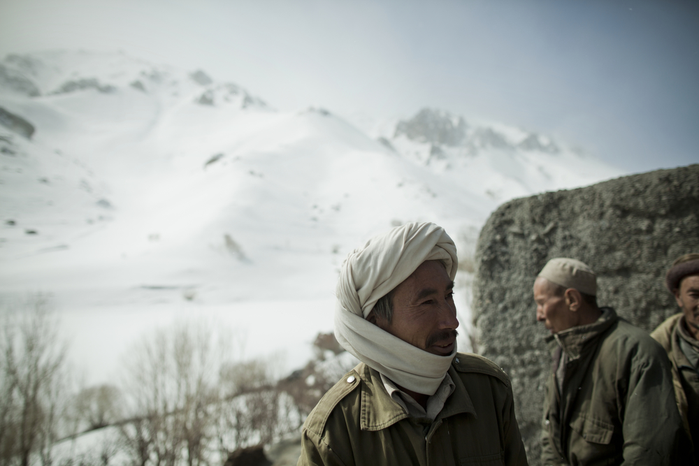 A local in a nearby village discusses the arrival of skiing in the area. Jawzari, Afghanistan. March 3, 2012