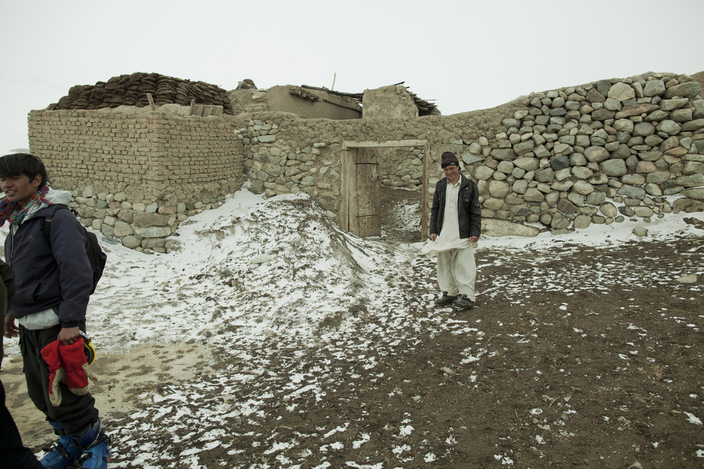 Khalil Reza, the winner of the Ski Challenge, in front of his home in Ali Beg, a remote mountain village near Bamiyan. Ali Beg, Afghanistan. March 4, 2012