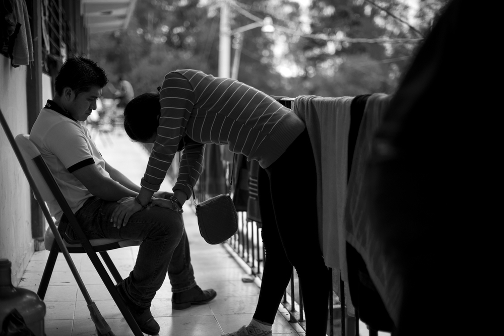 Two students from a normal teachers college in Chiapas spend time together outside the classroom where they've been living at the Ayotzinapa normal school. Ayotzinapa, Mexico. November 13, 2014.