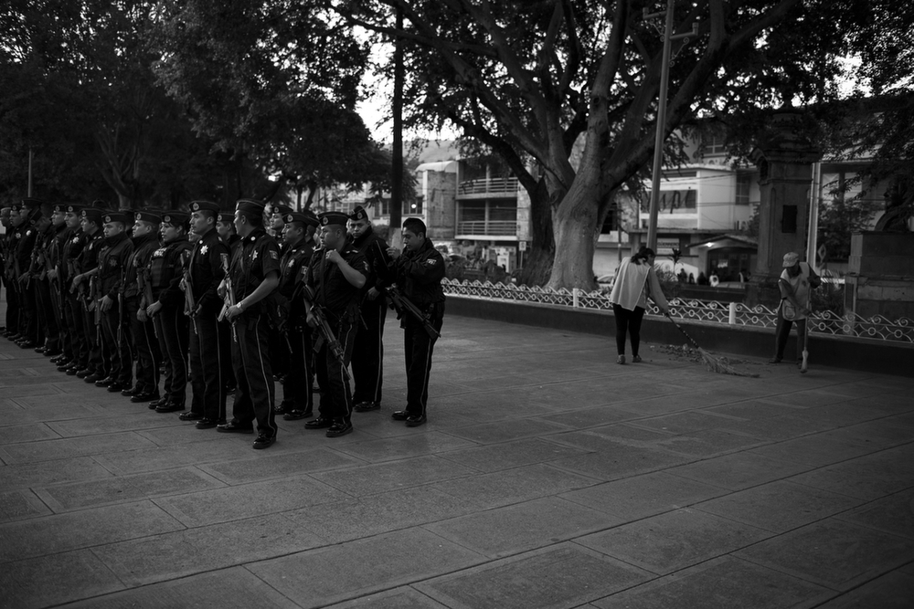 Federal police gather for their morning formation in Iguala, Mexico. In the wake of the students' disappearance and widespread civil unrest, the federal government dissolved municipal police forces across the country and replaced them with state and federal police. Iguala, Mexico. December 5, 2014.