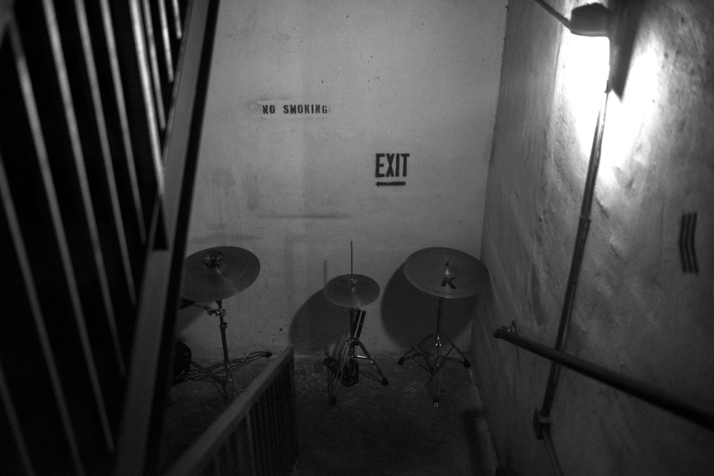 8PM—The opening band's cymbals are stashed in a backstage stairwell.