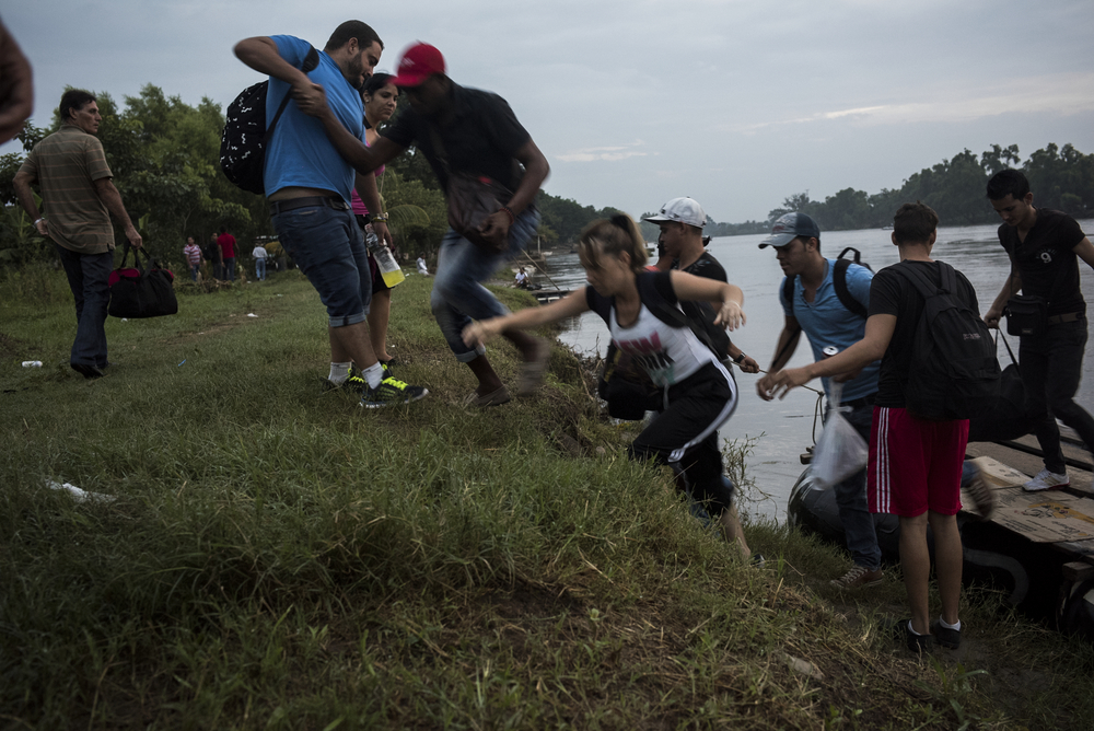 Cuban refugees come ashore on the Mexican side of the Suchiate River after crossing from Guatemala. While this is the last country they have to traverse before reaching the United States, it's also considered the most dangerous for them as they navigate corrupt government officials, gangs, and human traffickers.