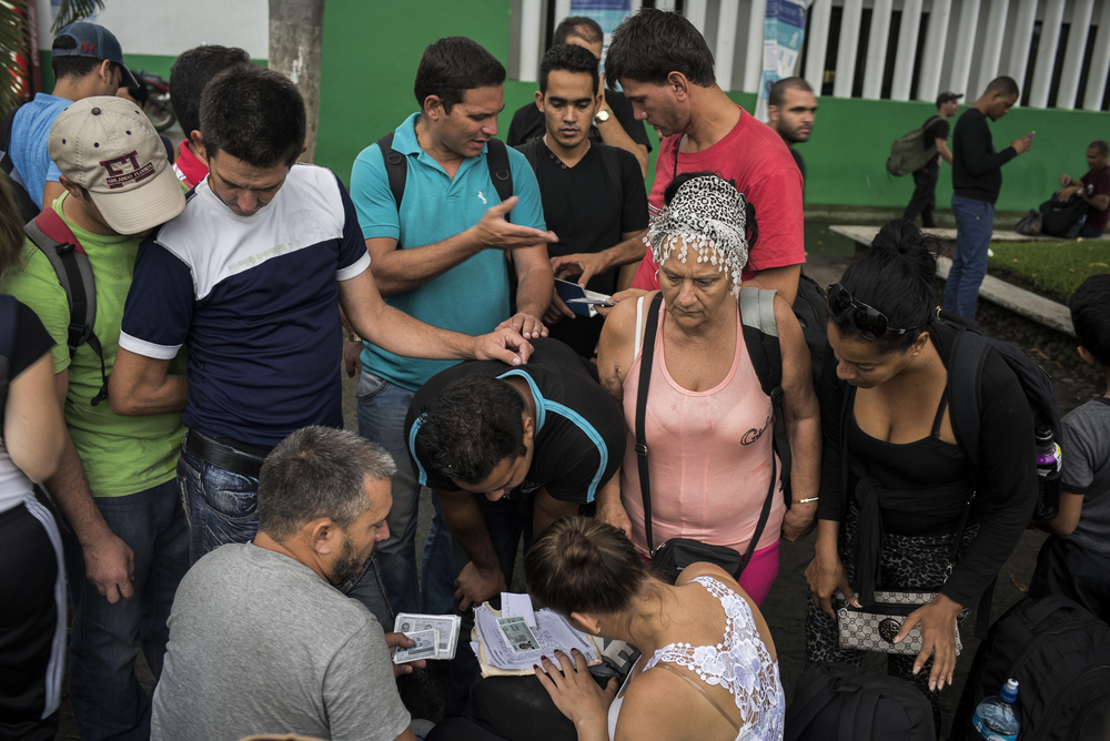 Cuban refugees put their names on a list to be processed for a Mexican exit visa along with roughly 200 others who arrived that day outside the Mexican migration office in Tapachula, Mexico. The migration office has been overwhelmed in the past couple of weeks by a surge of Cubans all making their way through Mexico to the United States.