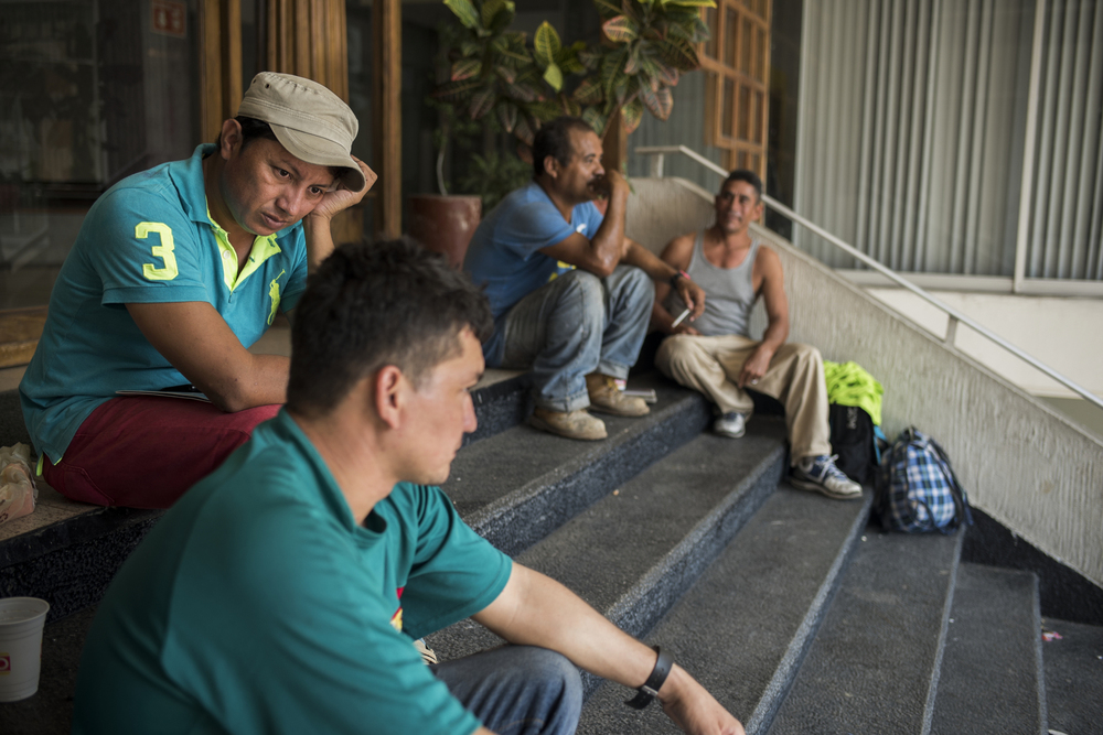 Danilo and his friend Alexander Jesus in front of the COMAR offices (Comisión Mexicana de Ayuda Refugiados) waiting to hear if their asylum applications had been approved. For weeks he spent everyday  there waiting, some days for as long as 7 or 8 hours.