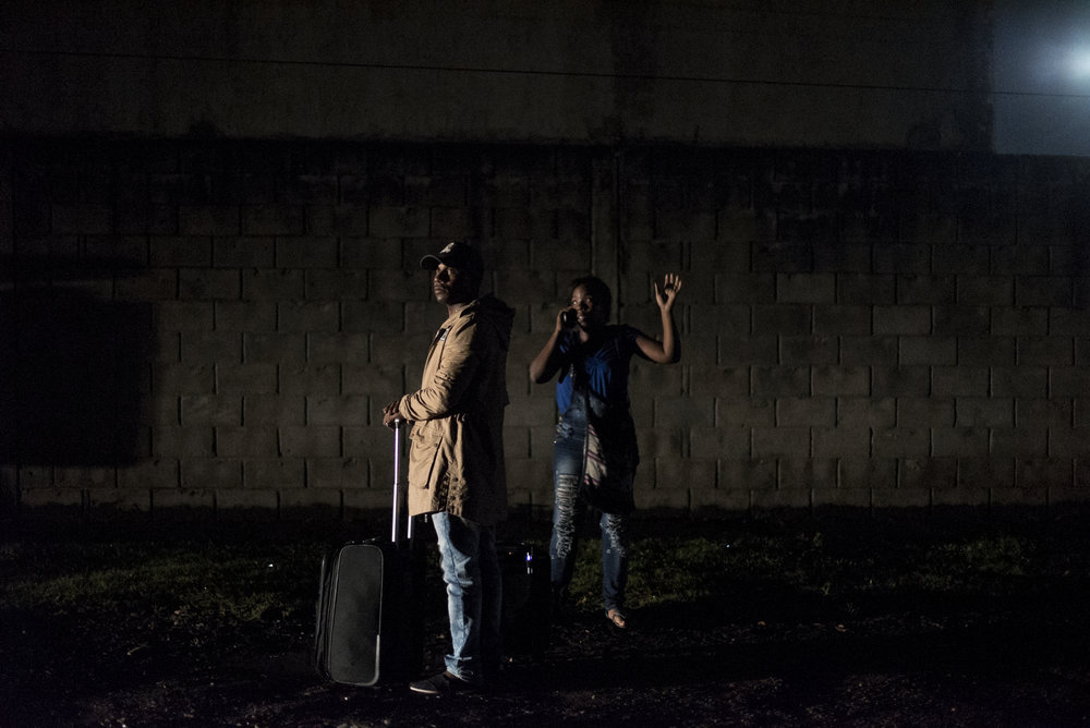 Osmani Arango and Zenia Correa stand on the side of the road in Tapachula after finally receiving their Mexican exit visa. They had no money left and didn't know where they were going sleep that night or how they were going to make the 1,100 mile journey to the U.S.-Mexico border.