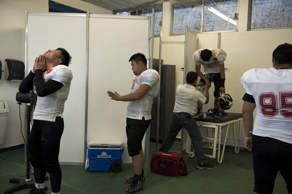 Chinese players in the locker room moments before taking the field for their final game of the 2016 American Football World University Championship on June 10, 2016 in Monterrey, Mexico.
