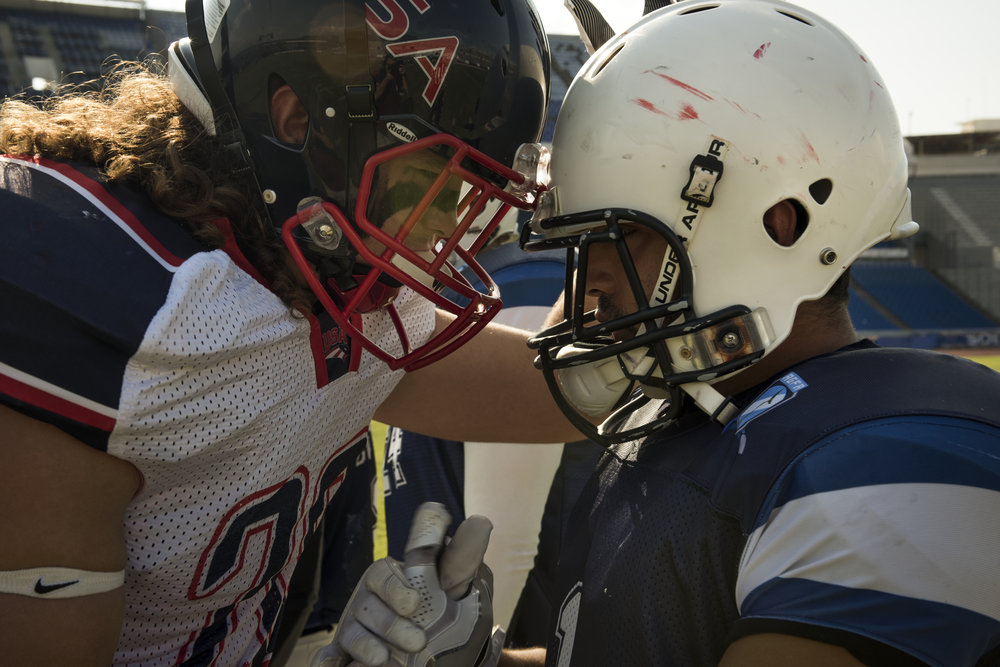 A U.S. player offers some supportive words to Guatemalan wide receiver Eric Illezcas moments before the two teams face each other at the 2016 American Football World University Championship on June 09, 2016 in Monterrey, Mexico. The Guatemalan team was excited for the chance to play the U.S. and throughout the game demanded that their U.S. opponents not take it easy on them so that they could learn.