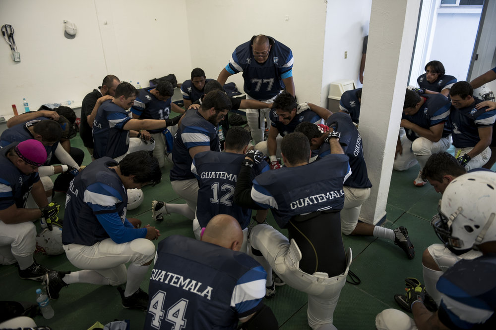 Guatemalan offensive lineman Hessler Champet leads the team in a prayer before taking the field for their last game of the 2016 American Football World University Championship against the United States on June 09, 2016 in Monterrey, Mexico.