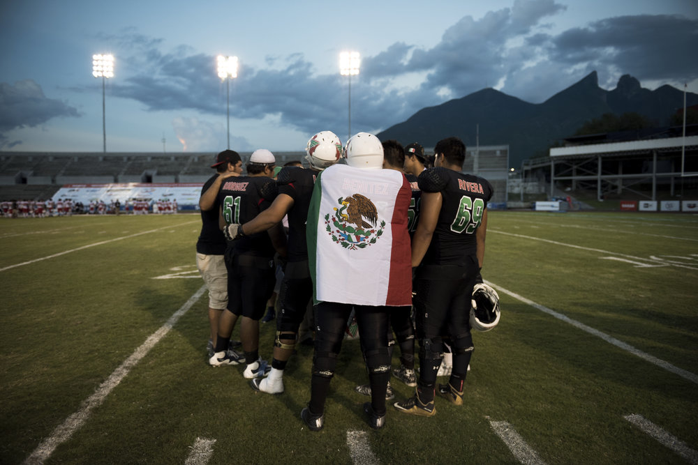 Offensive lineman Omar Edgar Benitez Palma drapes himself in the Mexican flag after his team's 36-3 victory over Japan at the 2016 American Football World University Championship on June 08, 2016 in Monterrey, Mexico. American football is hugely popular in Mexico and the country fielded a formidable team for this tournament.