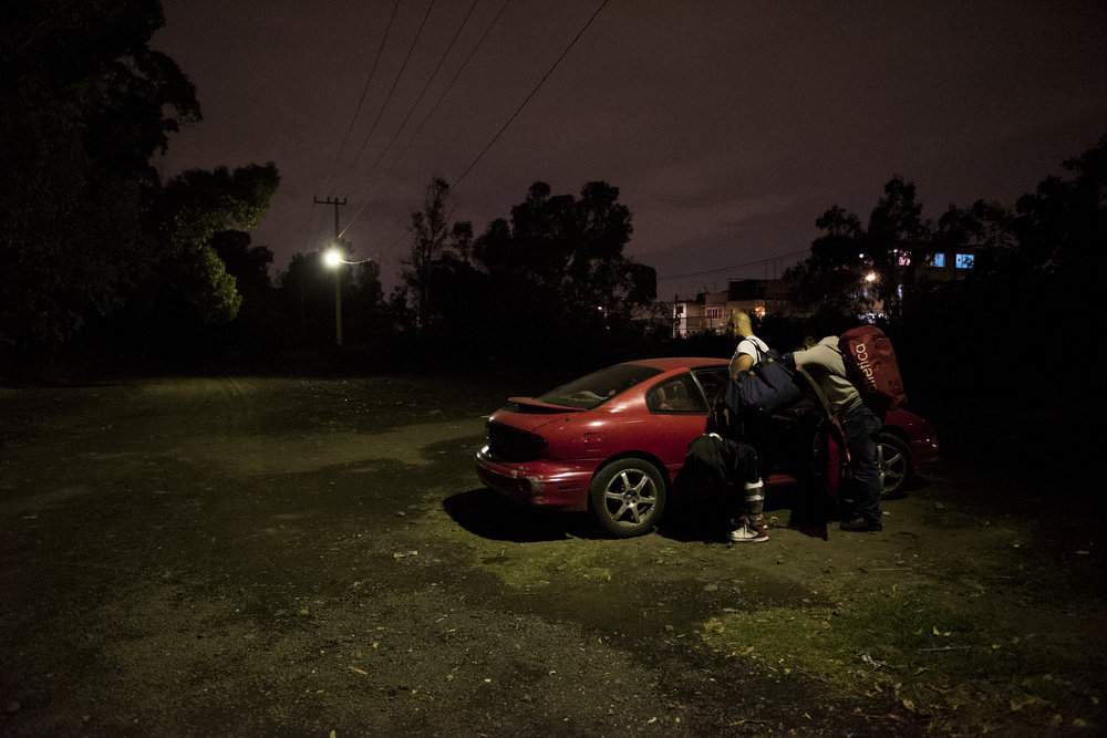 LFA players manage busy lives. Because the league doesn't yet pay enough they all have full time jobs outside of football. Here, players pile into a car after an evening, mid-week practice.